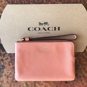 COACH Wristlet.Peach with gold detail.New w/ tags.